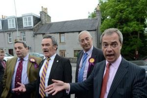 Coburn, left, with UKIP leader Farage on campaign trail